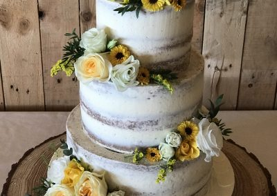 tiered kent buttercream cake with flowers