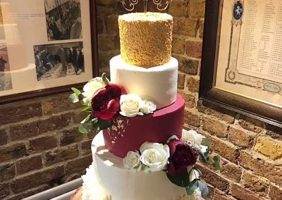 tiered coloured kent buttercream cake