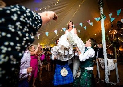 Scott Kendall Bride lifted high