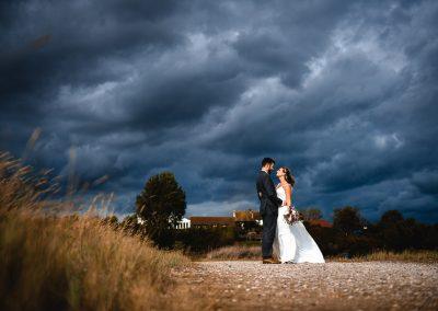 Bride and groom against ominous sky