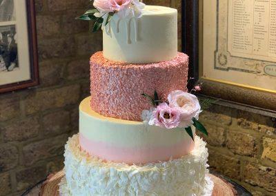 tiered pink & white wedding cake
